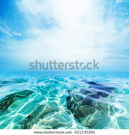 Underwater Sea Beach background / Blue waves and blue sky - stock photo