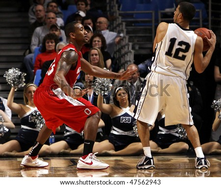 UNIVERSITY PARK, PA - FEBRUARY 24: Ohio State guard William Bufford #44 defends Talor Battle #12 in a game against Penn State at the Byrce Jordan Center February 24, 2010 in University Park, PA - stock photo