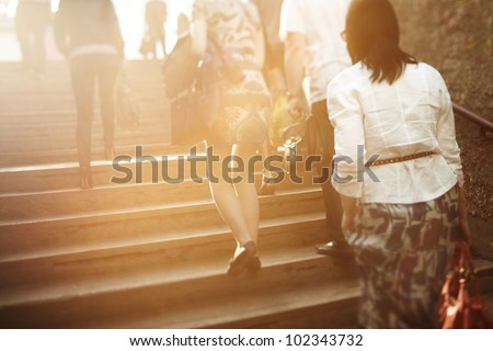 unrecognizable people are blurred with a tilt-shift lens, natural sunlight - stock photo