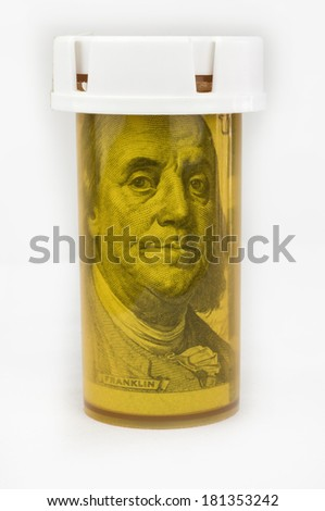 $100 US Bank Note in Pill Medicine Bottle - stock photo