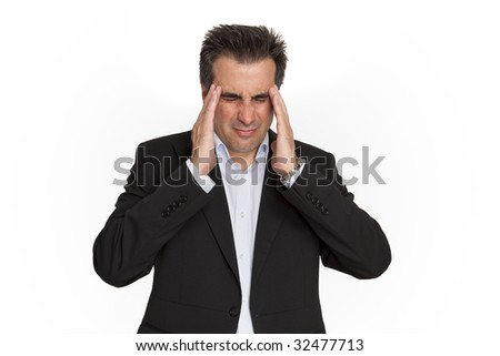 ?usinessman touches his head from the headache. - stock photo