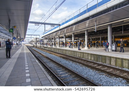 UTRECHT, NETHERLANDS, on March 30, 2016. Passengers wait for the train on the platform of the railway station