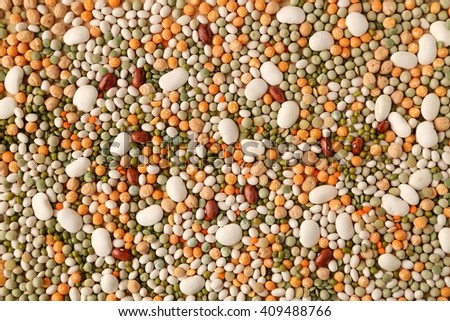 Variety of coloured beans and lentils. Food background. - stock photo