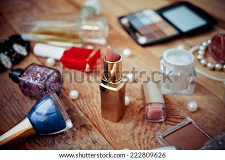 Various makeup products on  wooden background - stock photo