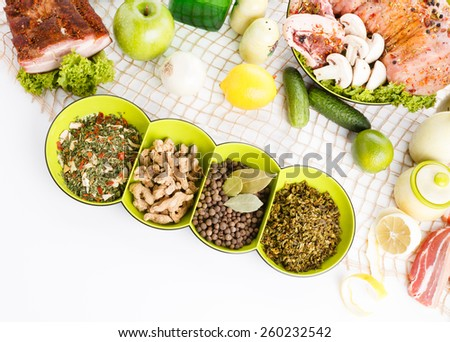 various meal type like polish sausage smoked bacon meat roasted chicken leg bread herb boiled eggs on tablecloth - stock photo