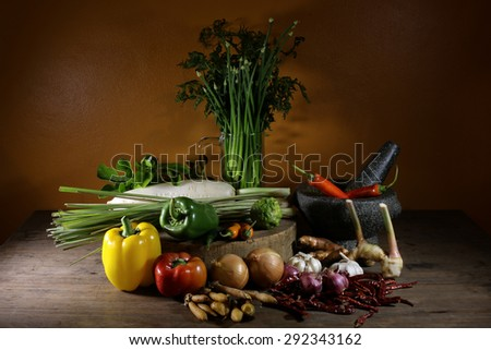 Vegetables and equipment for food on wooden table, still life style - stock photo