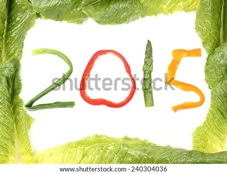 2015 vegetables bound by lettuce border to welcome in the New Year suggesting healthy eating habits - stock photo