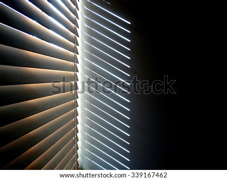 Venetian blinds with shadows                           - stock photo
