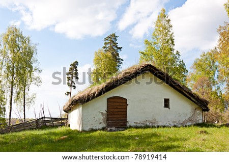 Very old cottage on sweden, grass on the roof.