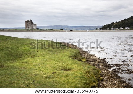 View of Lochranza bay and the castle. - stock photo