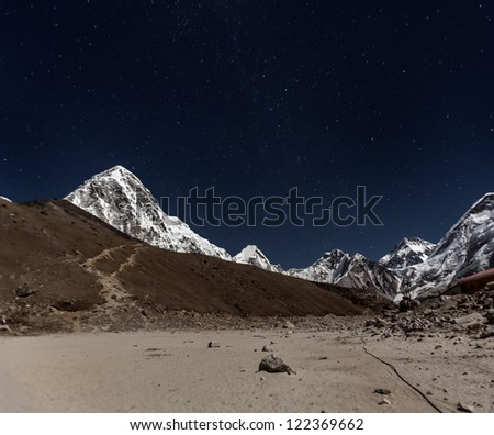 View of Pumo Ri in the Moonlight from Gorak Shep - Everest region, Nepal, Himalayas - stock photo