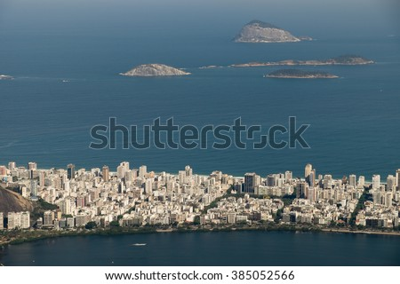View of Rio de Janeiro's skyline and amazing topography from Christ Redeemer at Corcovado. Rio de Janeiro, Brazil. In this case can be seen some of the islands in front of Ipanema Beach. - stock photo