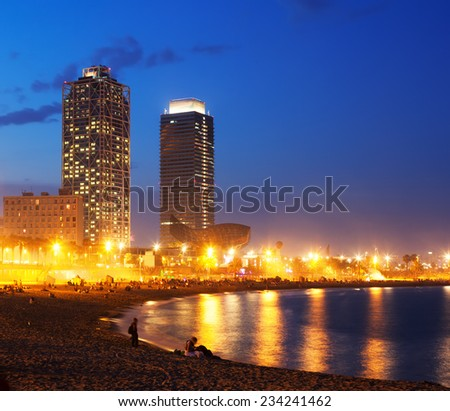 View of Somorrostro Beach and towers of Port Olimpic in summer evening in Barcelona, Spain - stock photo