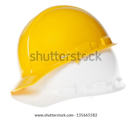 45�° view of two hard hats, yellow on top of white, isolated on white background. - stock photo