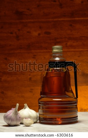 Vinegar and garlic on a brown background