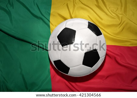 vintage black and white football ball on the national flag of benin