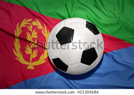 vintage black and white football ball on the national flag of eritrea - stock photo