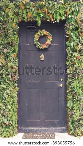 ?Vintage black wooden door with decoration flower arch