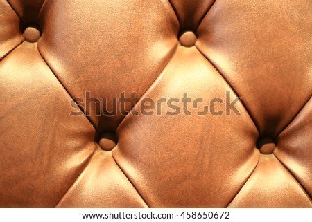 Vintage brown leather Sofa Button for textured background - stock photo