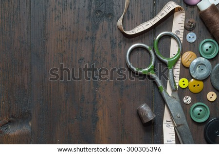 vintage buttons on old wooden table - stock photo