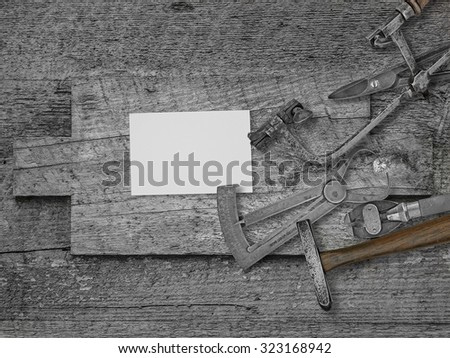 vintage jeweler tools and diamond over wooden bench, blank card for your business - stock photo