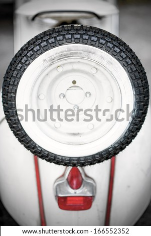 vintage motorcycle with spares wheel - stock photo