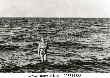 Vintage photo of woman in sea, fifties - stock photo