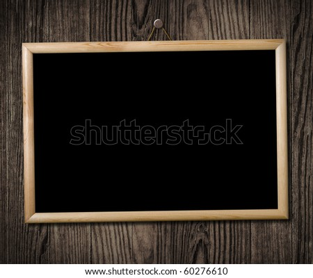 Vintage picture frame hanging on a wooden wall, clipping path. - stock photo