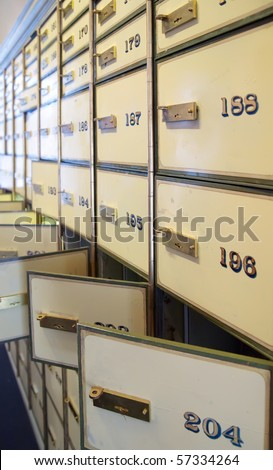 vintage safe deposit boxes. Locked and opened - stock photo