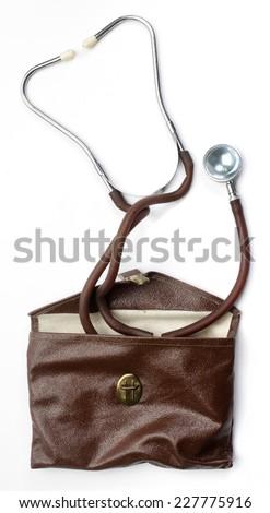 Vintage stethoscope on white background. - stock photo
