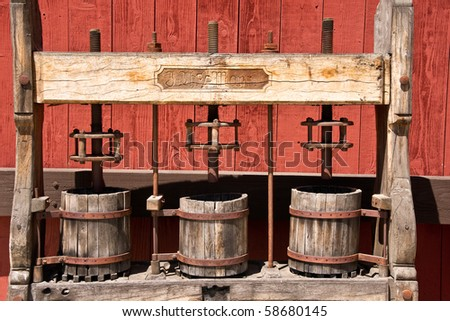 3 vintage wine presses at a Paso Robles, California winery - stock photo