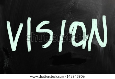 """Vision"" handwritten with white chalk on a blackboard"