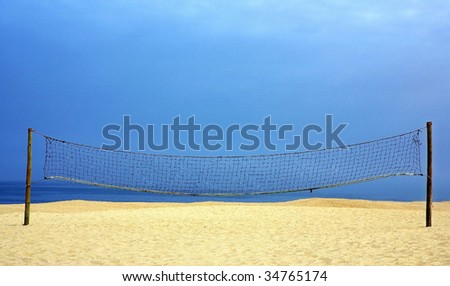 Volleyball net on the portuguese beach. - stock photo