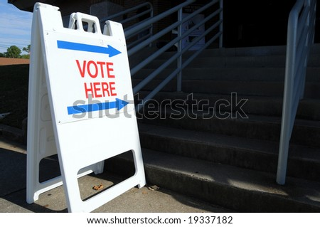 """Vote here"" to direct voters to the polling place - stock photo"