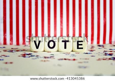 """""""VOTE"""" printed on white dice with striped background and confetti lens effect - stock photo"""