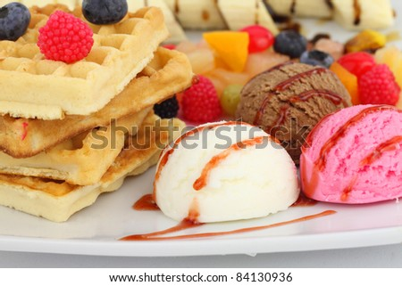 Waffles with ice cream and fruits - stock photo