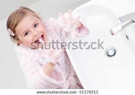 Washing hands is fun - stock photo