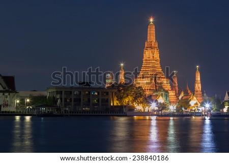 Wat Arun temple along with Bangkok river thailand - stock photo