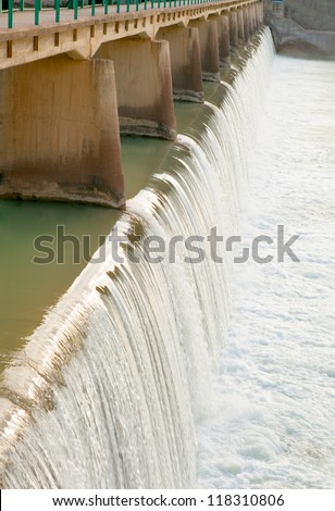 Water flowing from the dam - stock photo