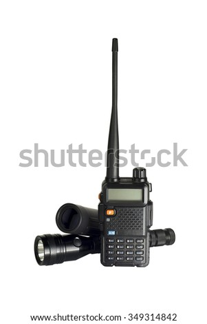 2-way radio with flashlight and monocular on white background - stock photo