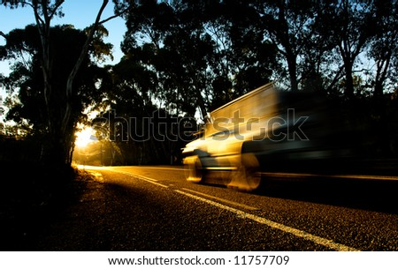 4wd heading into the sunset - stock photo