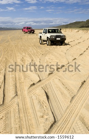 4WD tracks on beach highway - stock photo