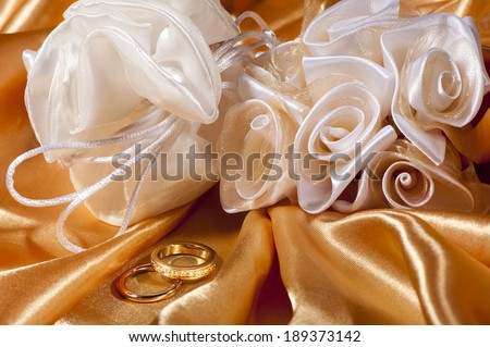 wedding rings on  a colorful fabric background - stock photo