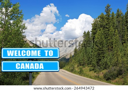 """Welcome to Canada ""  Blue road sign against  beautiful Canadian nature landscape with Rocky Mountains. Invitation to Canada ( visit and travel)"
