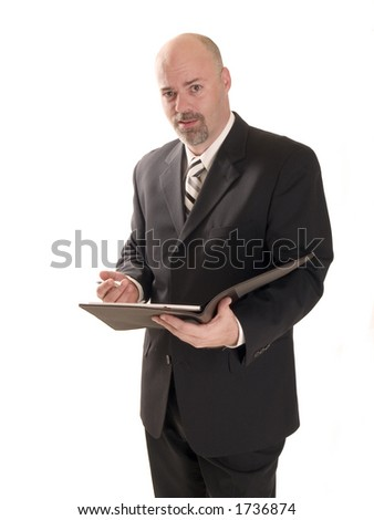 well dressed businessman upset about the information in the report. - stock photo