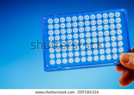 96 well PCR plate. Device for DNA research. Research leads to portable DNA testing device - stock photo