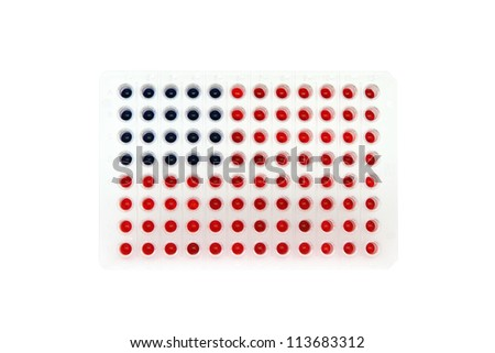 96 well plate with blue and red fluids represent USA flag - stock photo