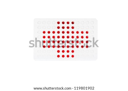 96 well plate with red fluids represent red cross - stock photo