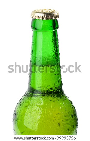 Wet green bottle of beer closeup on white background