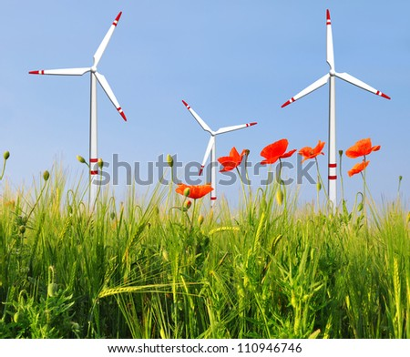 wheat fields with red poppy and wind turbines - stock photo
